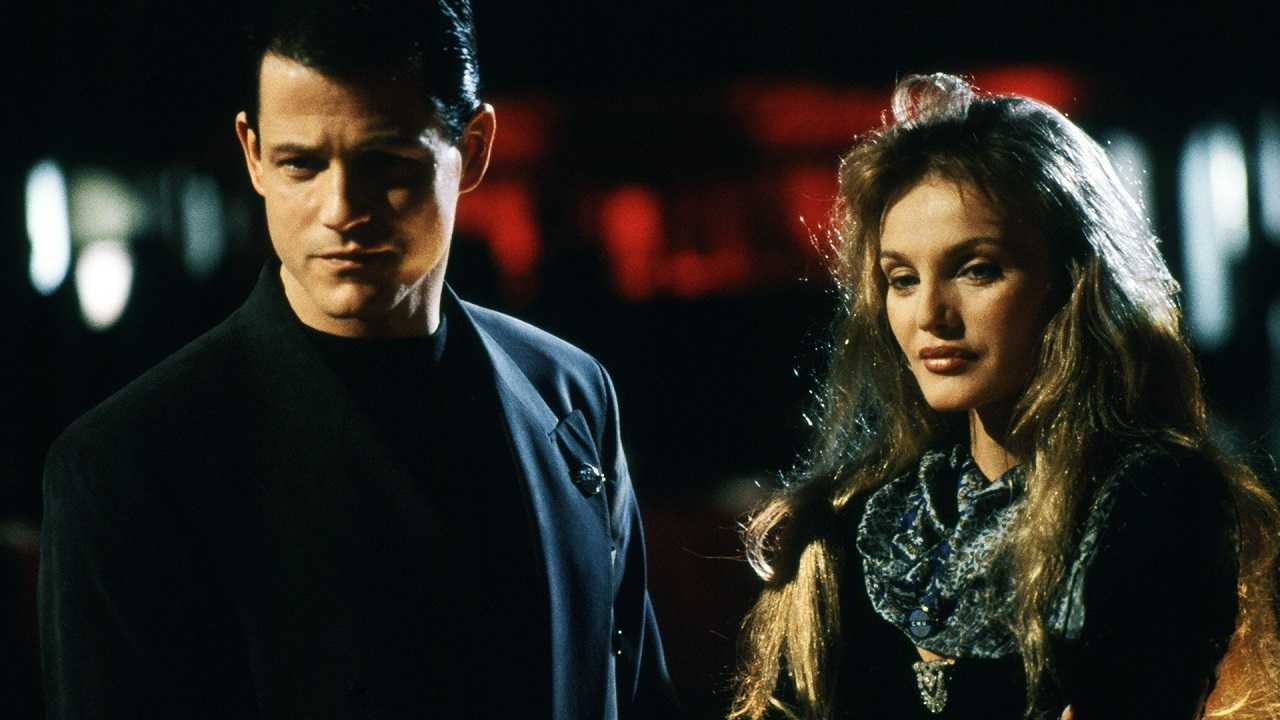 Michael Paré as The Anti-Christ Colin Gramercy with Arielle Dombasle in Raging Angels (1994)