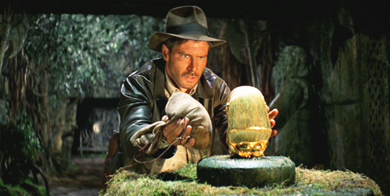 Indiana Jones (Harrison Ford) retrieves the gold idol in Raiders of the Lost Ark (1981)