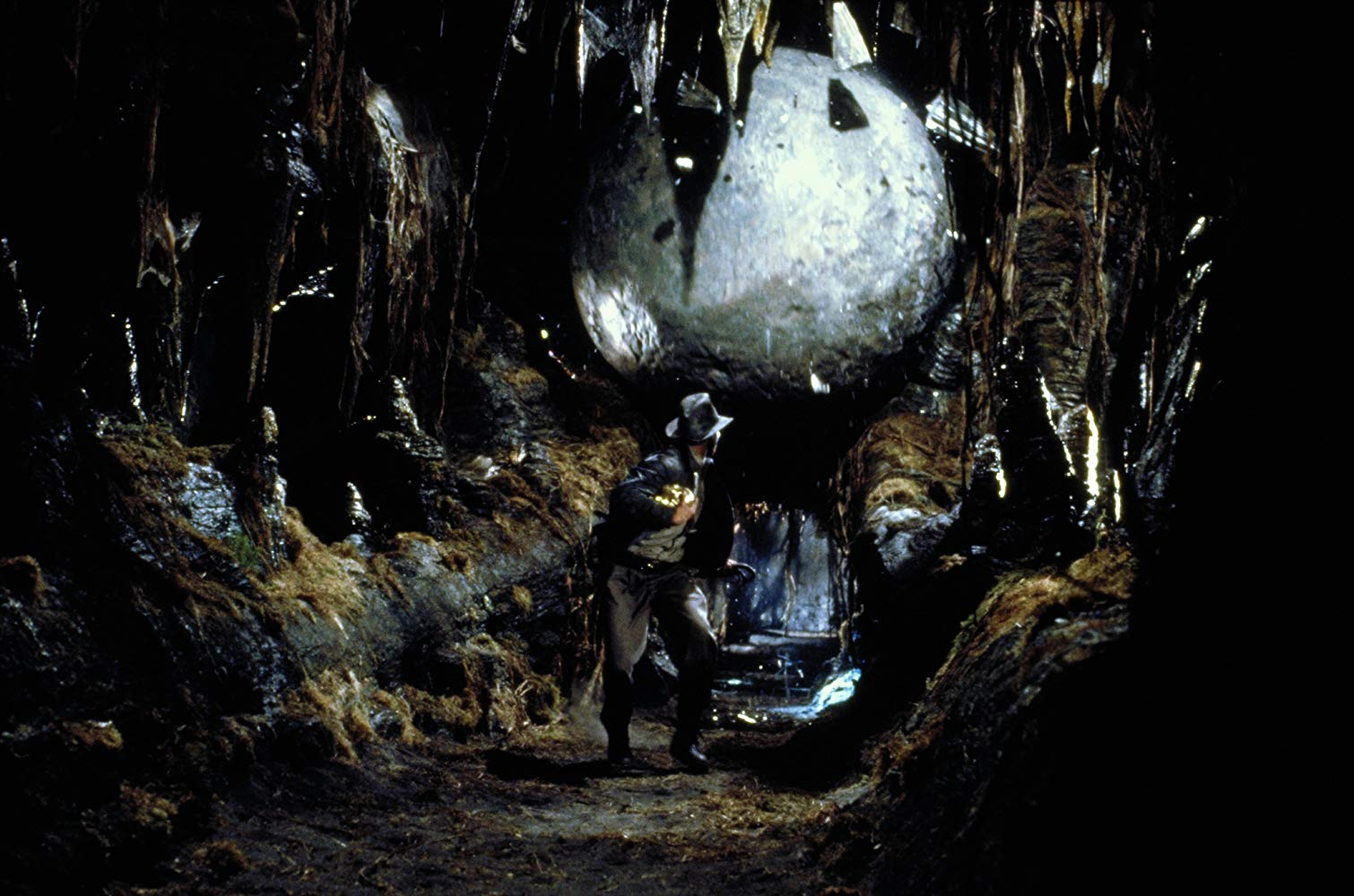 Harrison Ford on the run from boulder in Raiders of the Lost Ark (1981