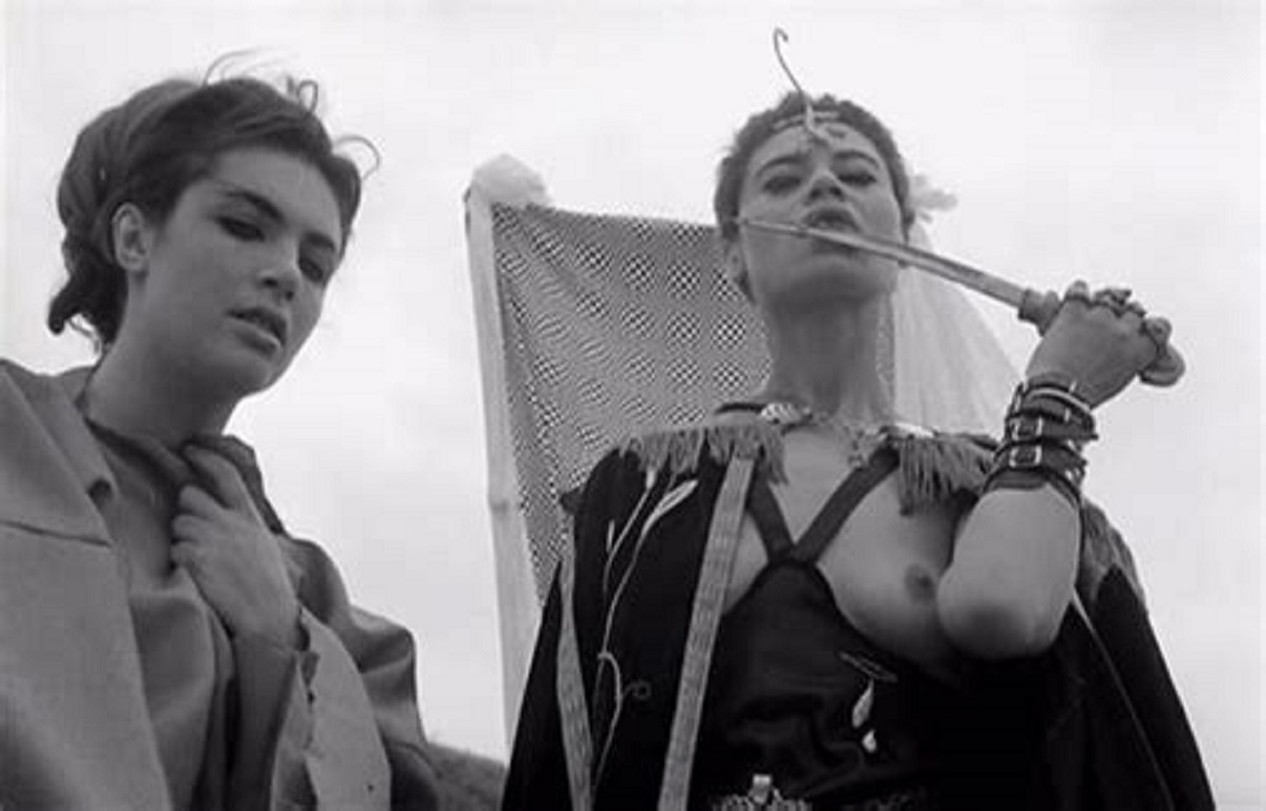The Queen of the Vampires (Jacqueline Sieger) (r) tastes the sacrificial knife in The Rape of the Vampire (1968)