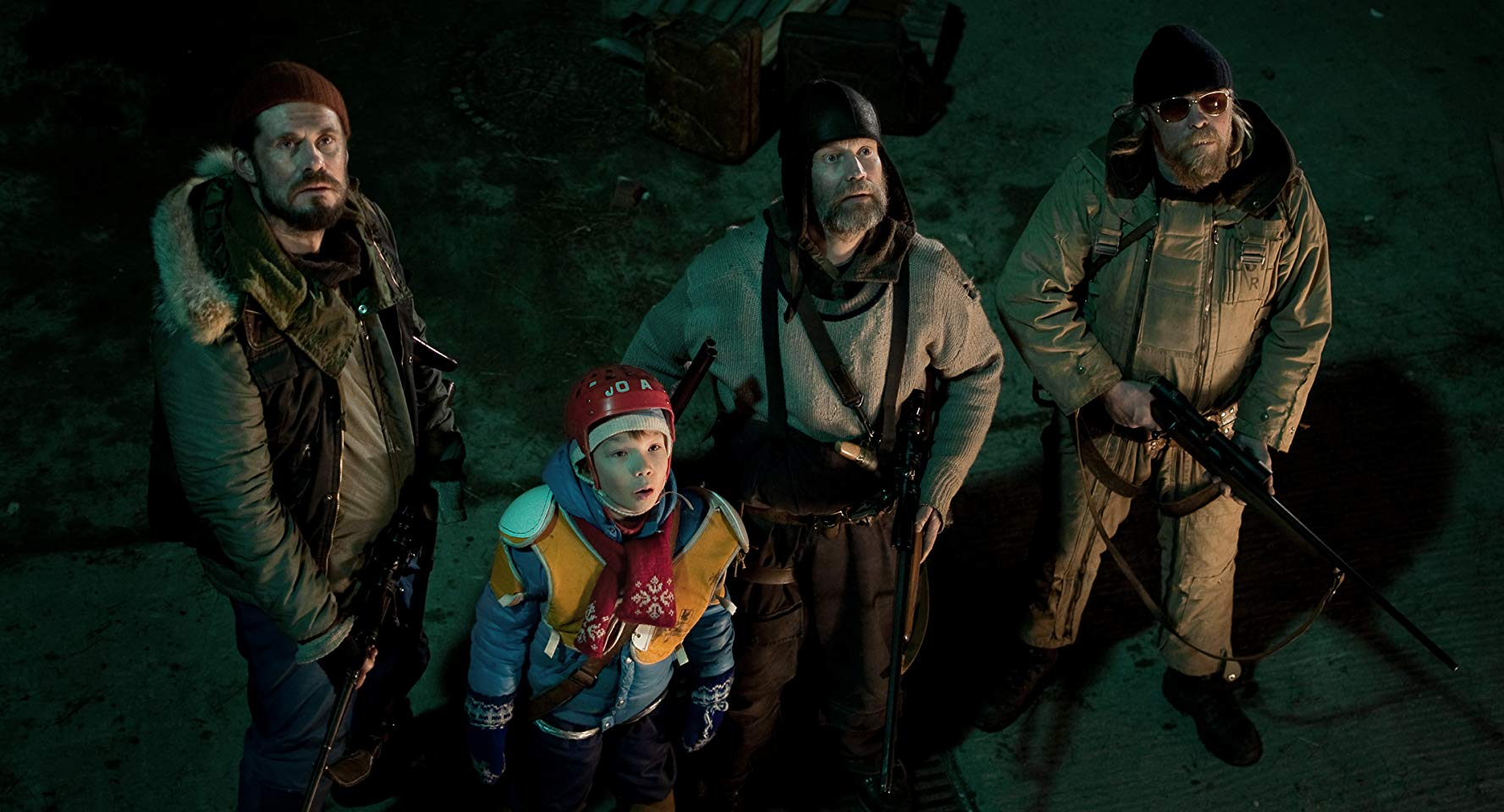 Tommi Korpela, Onni Tommila, Jorma Tommila, Rauno Juvonen deal with a rampaging Santa monster in Rare Exports (2010)