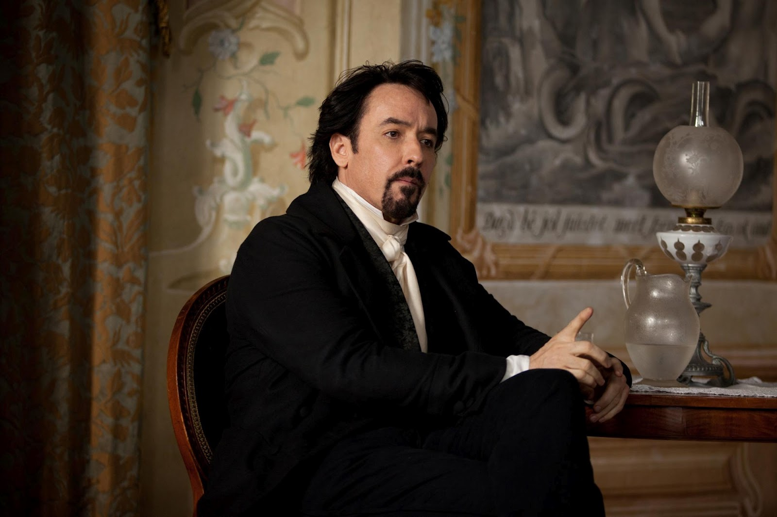 John Cusack as Edgar Allan Poe in The Raven (2012)