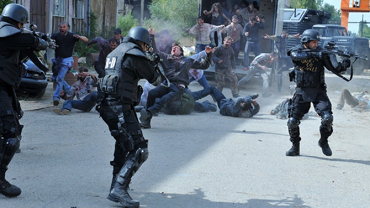 The soldiers fight off zombies in Re-Kill (2015)