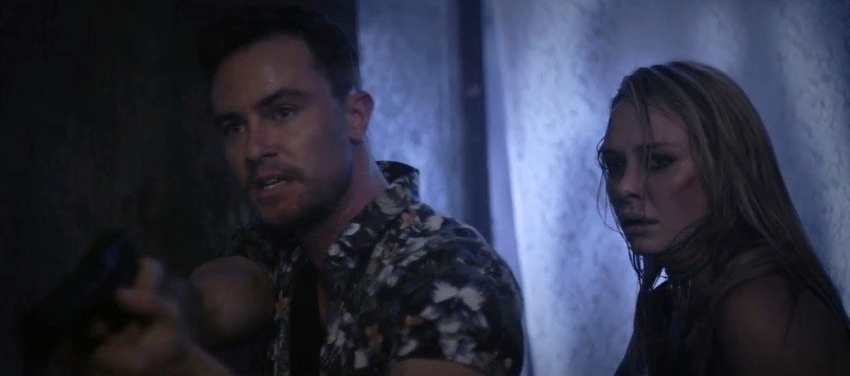 Armed robbers Ryan Kelley and Madison McKinley venture into a haunted house in Realms (2017)