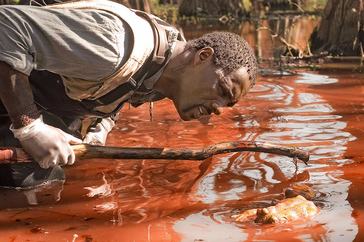 Idris Eba investigates a river of blood in The Reaping (2007)