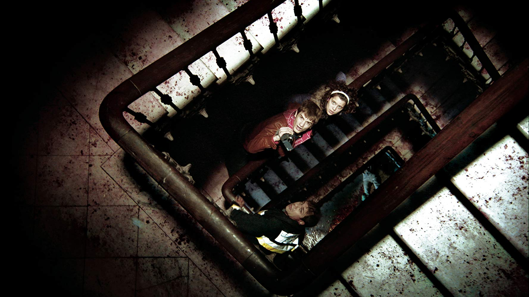 Survivors look for a way out - (top to bottom) Andrea Ros, Alex Battlori and Juli Fabregas in [Rec] 2 (2009)