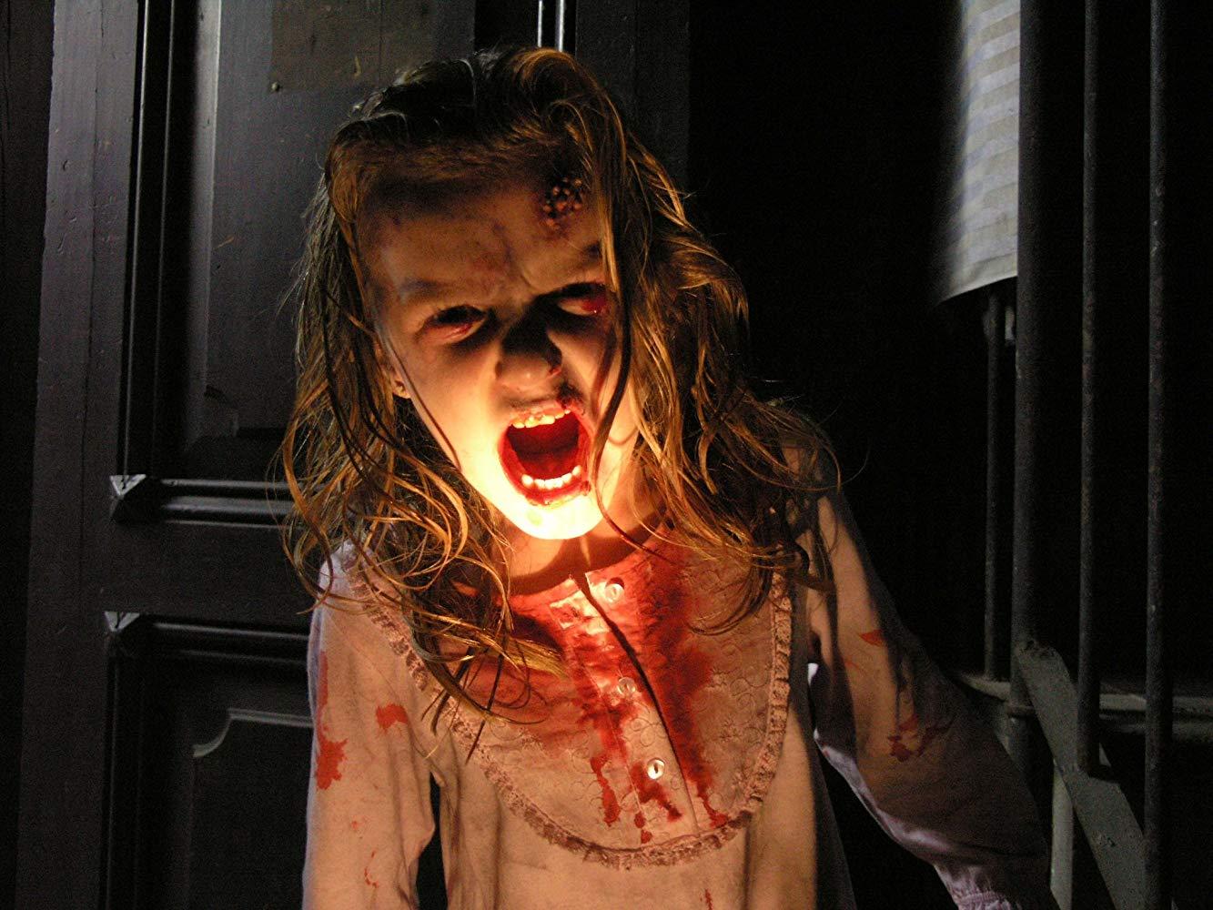 Zombie infected little girl (Claudia Silva) in [Rec] (2007)