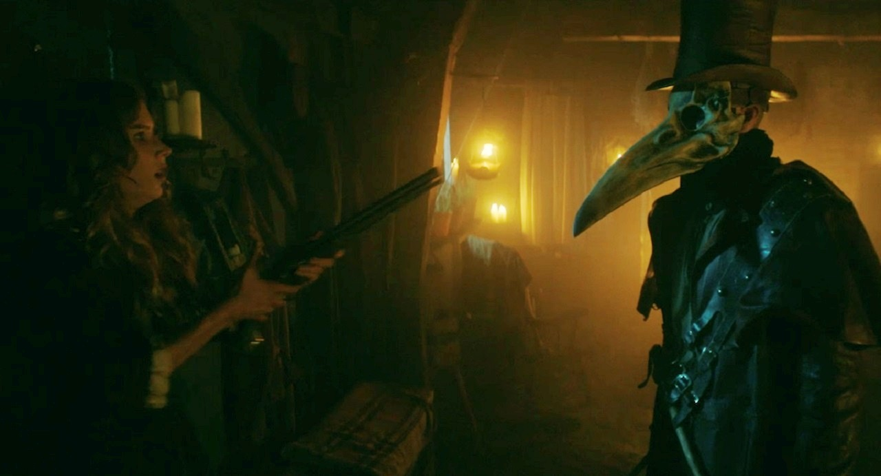 Charlotte Kirk confronts plague doctor in The Reckoning (2020)