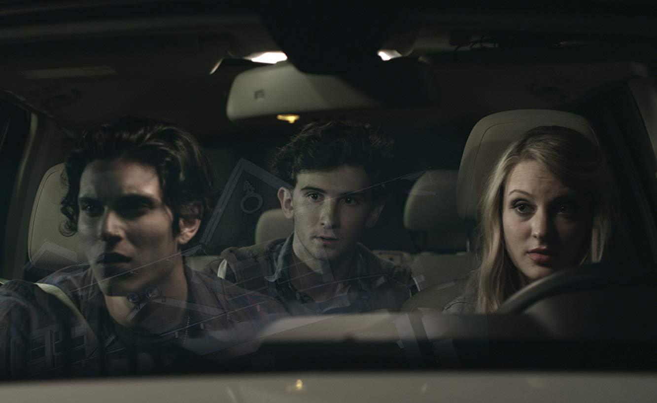 Kirby Bliss Blanton (r), younger brother Alex Shaffer (c) and date Samuel Larsen (l) set out to find her missing cellphone in Recovery (2016)