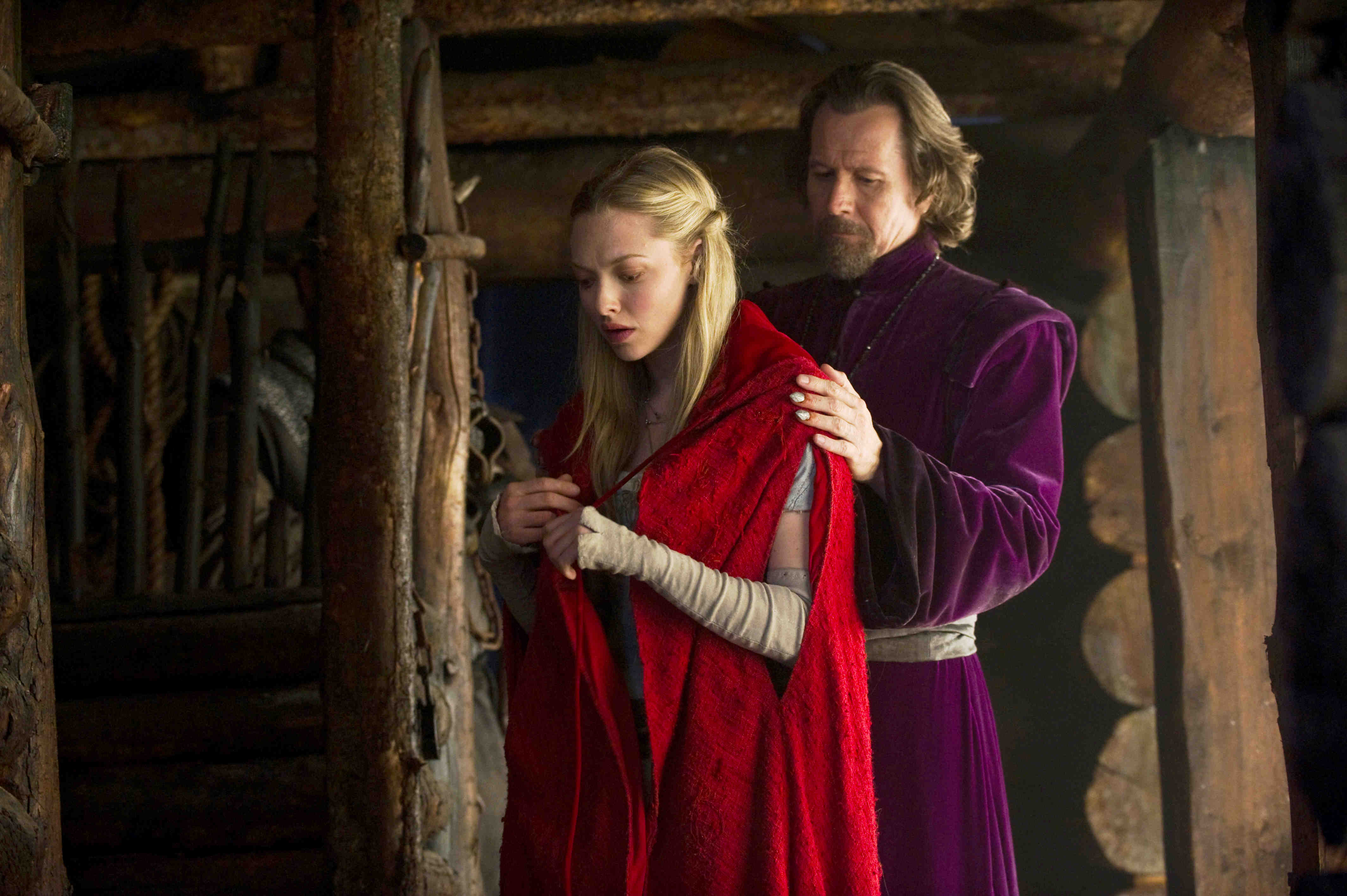Valerie (Amanda Seyfried) and the monster hunter Father Solomon (Gary Oldman) in Red Riding Hood (2011)