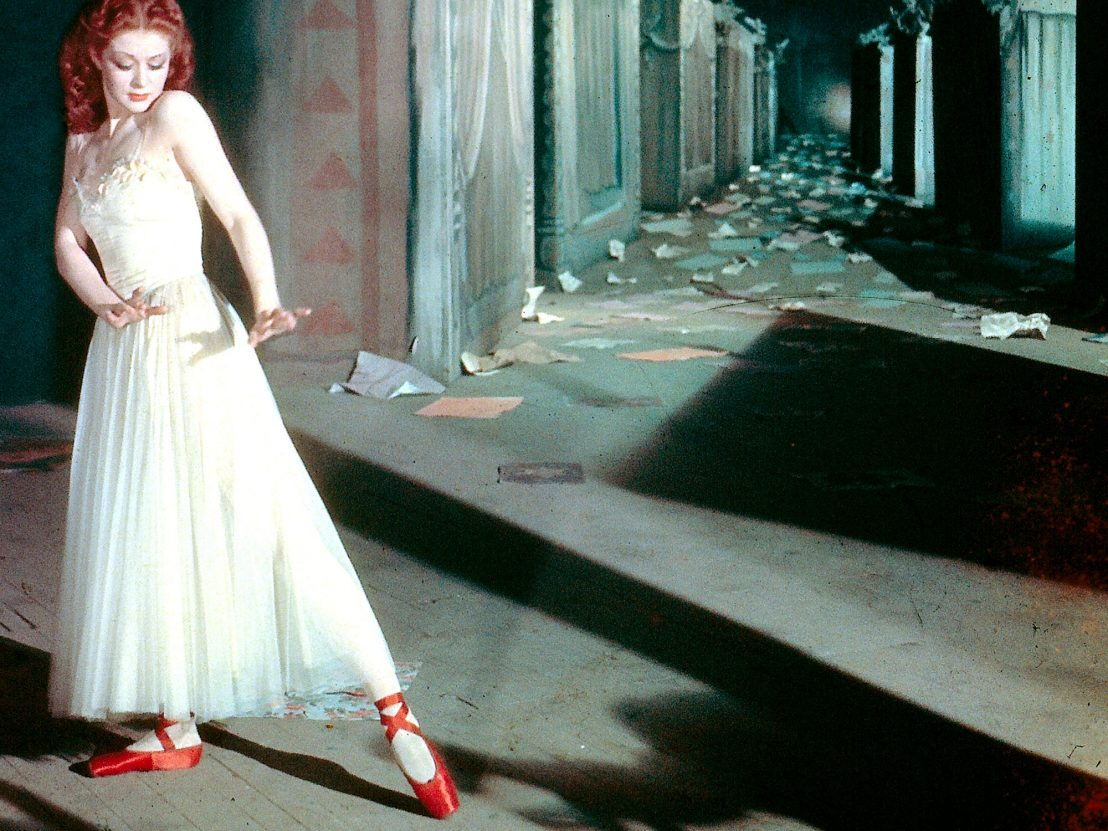 Moira Shearer wearing the red ballet shoes that take on a life of their own in The Red Shoes (1948)