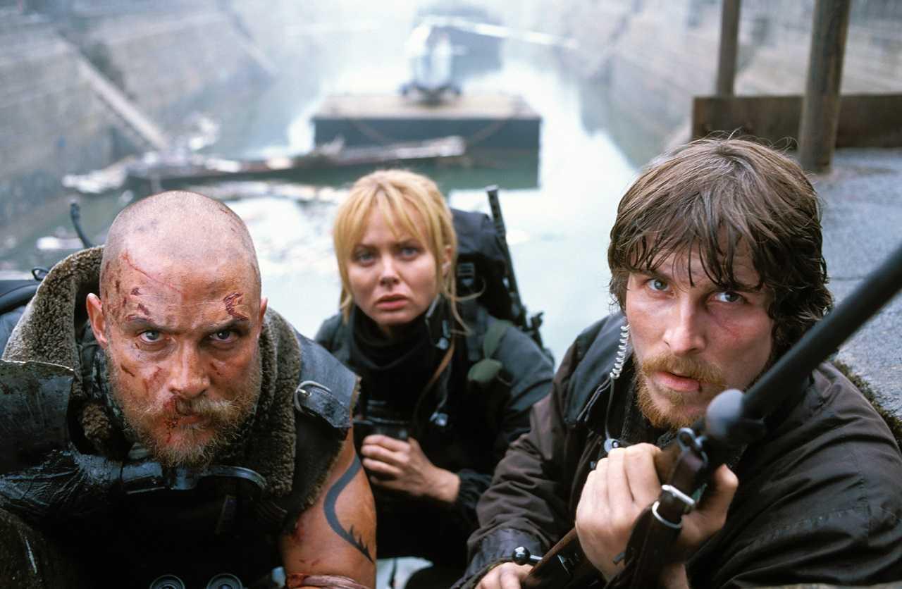 Van Zan (Matthew McConaughey), Alexandra Jensen (Izabella Scorupco) and Quinn Abercromby (Christian Bale) in Reign of Fire (2002)