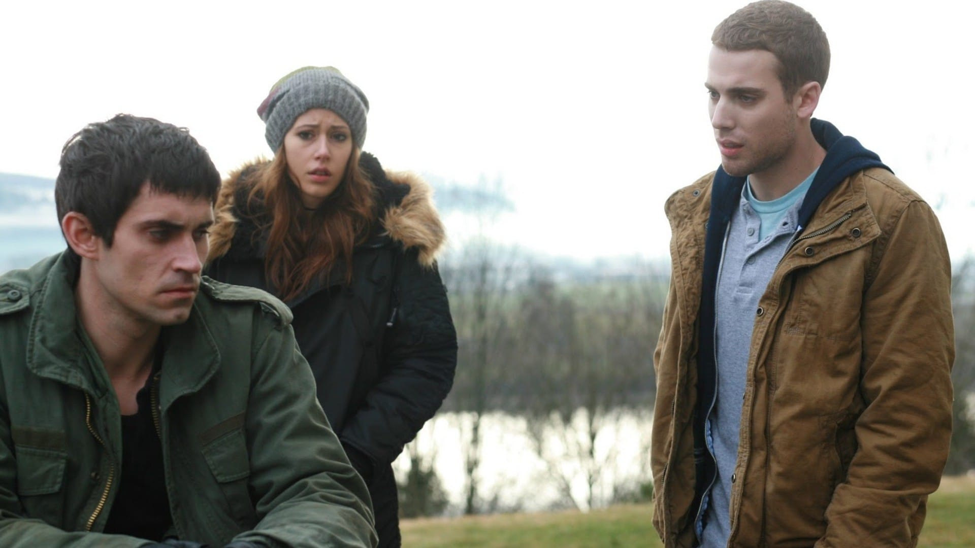 Three people caught in a timeloop - (l to r) Richard de Klerk, Amanda Crew and Dustin Milligan in Repeaters (2010)