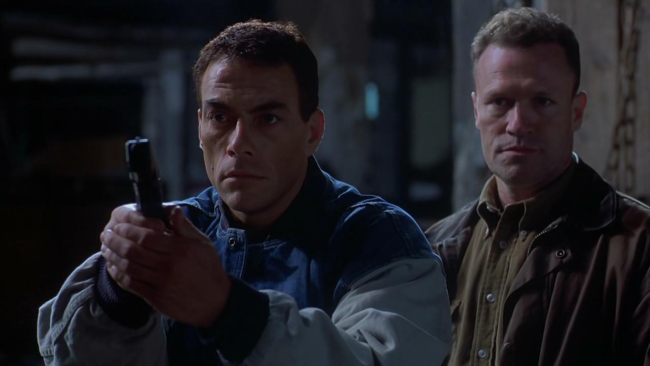 Jean-Claude Van Damme as the clone of a serial killer and detective Michael Rooker in Replicant (2001)