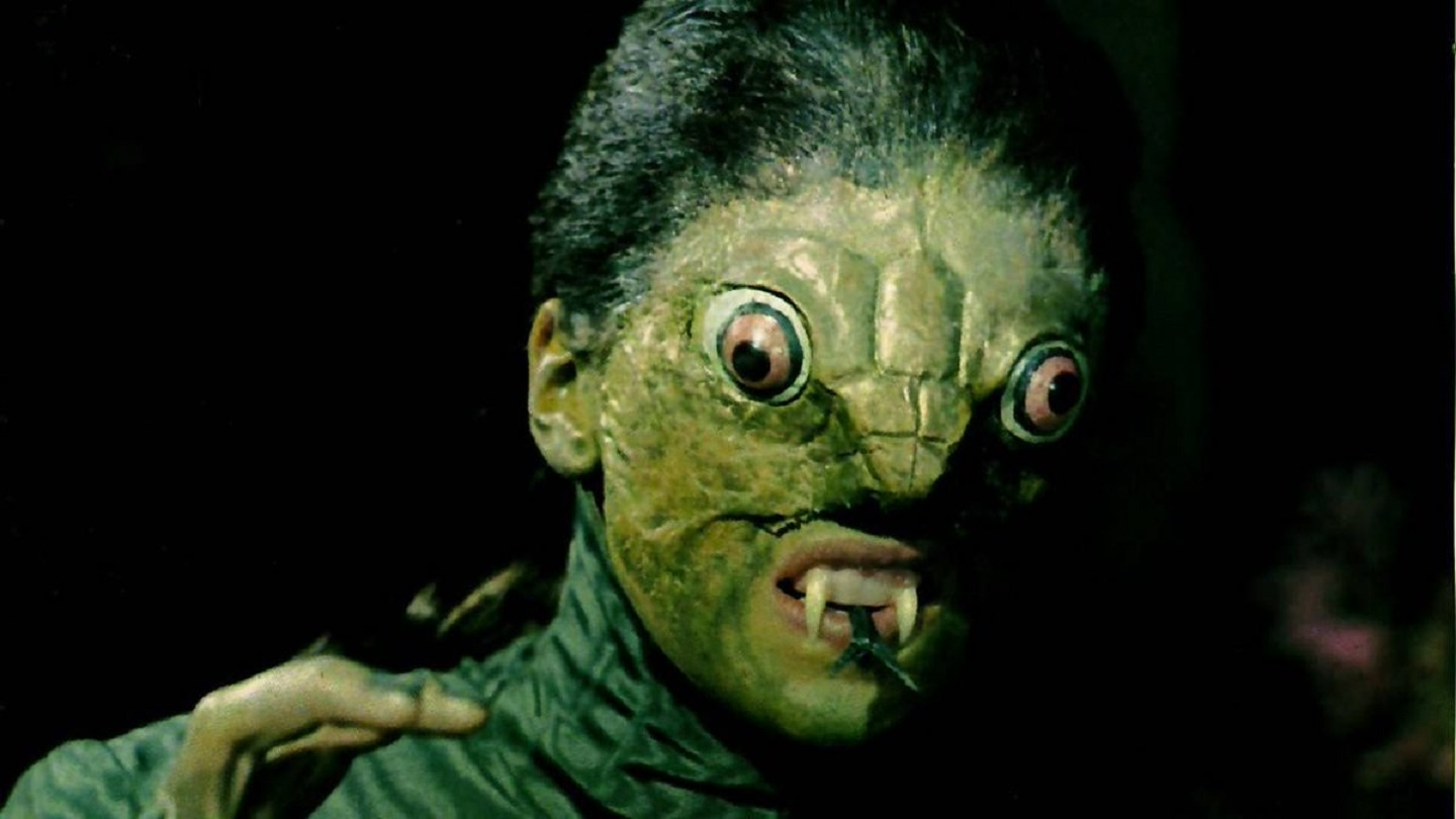 Jacqueline Pearce as The Reptile
