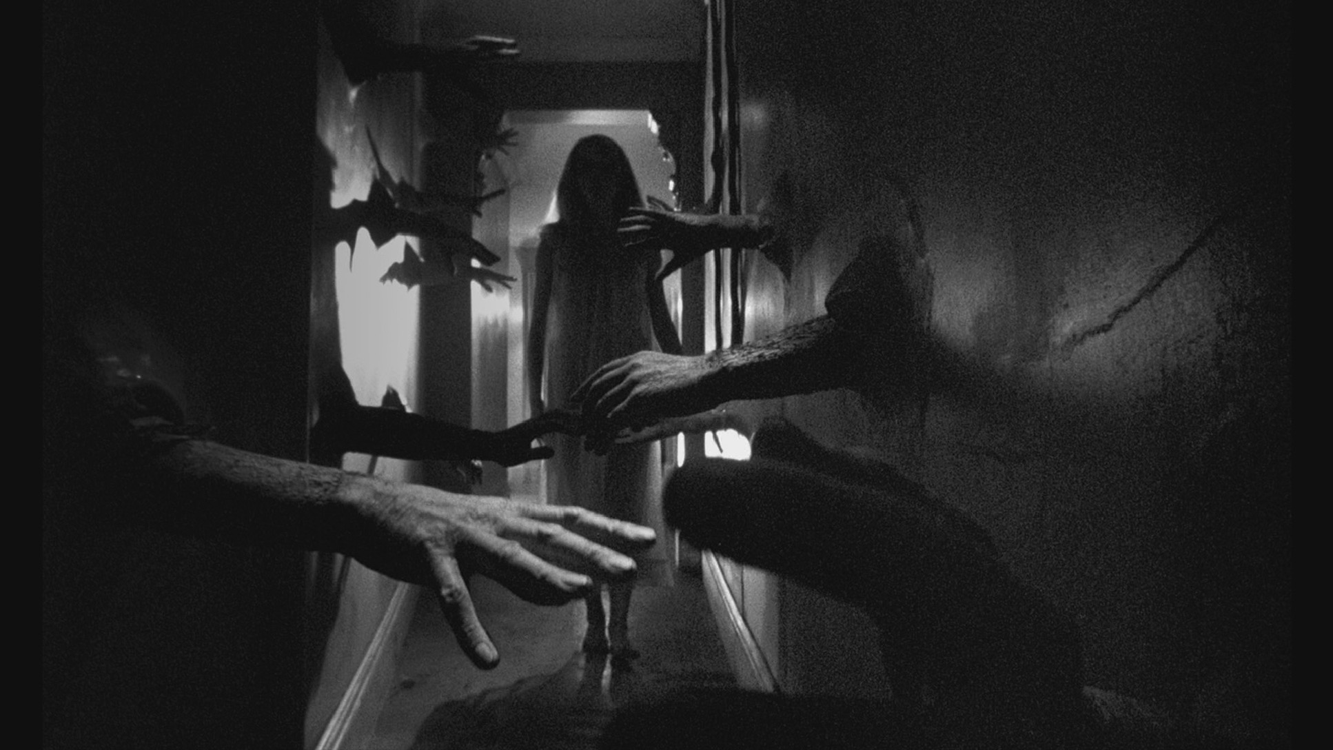 Catherine Deneuve and a wall of hands in Repulsion (1965)