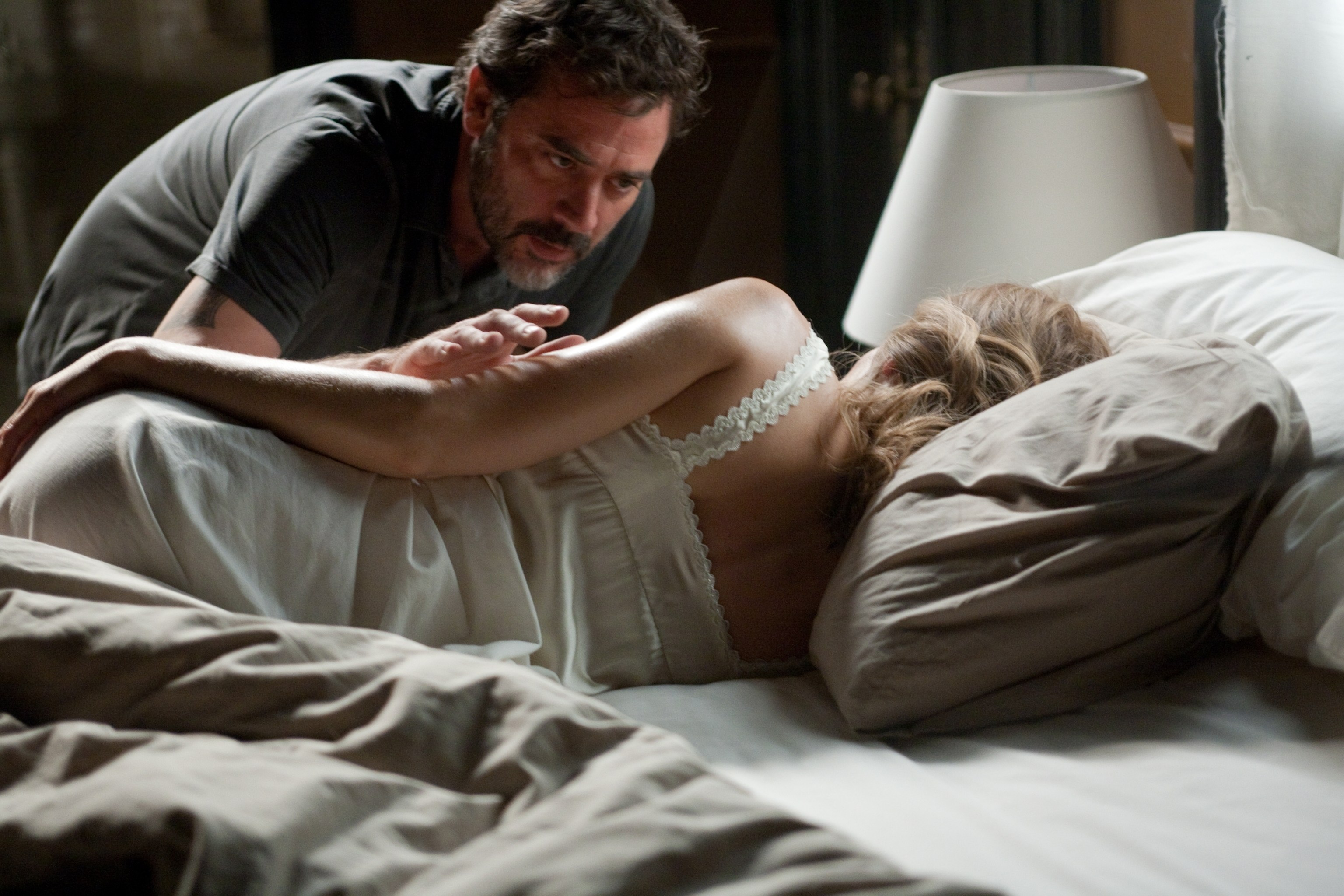 Creepy landlord Jeffrey Dean Morgan sneaks in on a sleeping Hilary Swank in The Resident (2011)