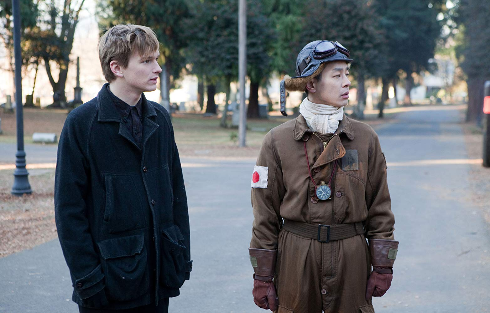 Henry Hopper and Ryo Kase as his ghostly companion, a Japanese kamikaze pilot from WWII in Restless (2011)
