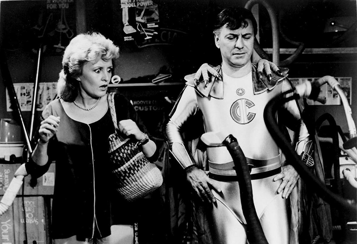 Reporter Kate Kitzpatrick and Captain Invincible (Alan Arkin) face killer vacuum cleaners in The Return of Captain Invincible (1983)