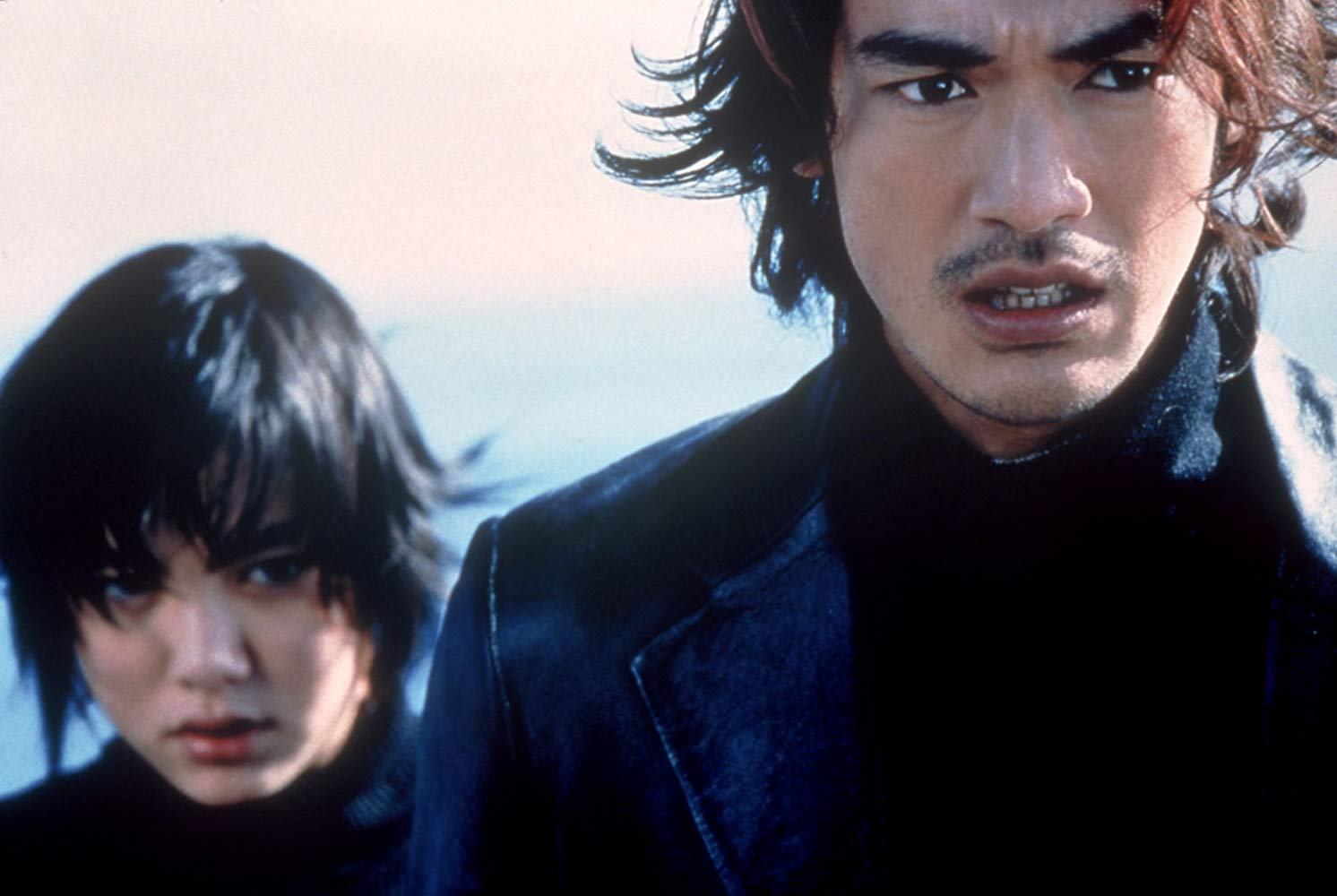 Milly (Anne Suzuki) and Miyamoto (Takeshi Kaneshiro) in the midst of time travel and alien invasion action in Returner (2002)