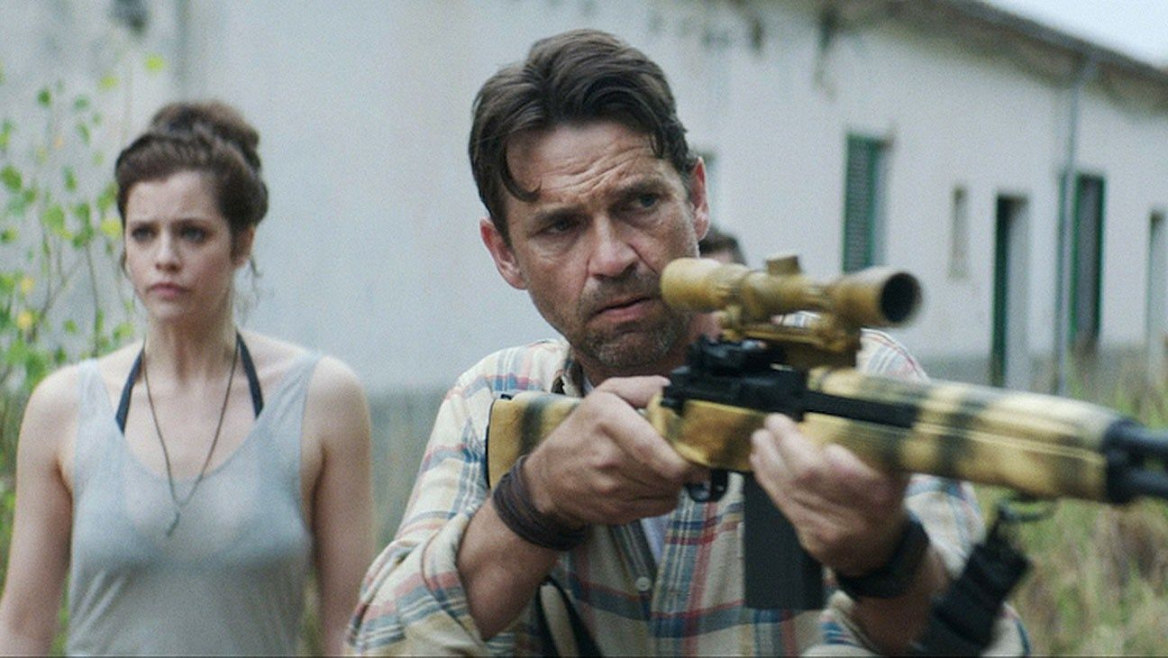 Jessica De Gouw and Dougray Scott go hunting zombies in The Rezort (2015)