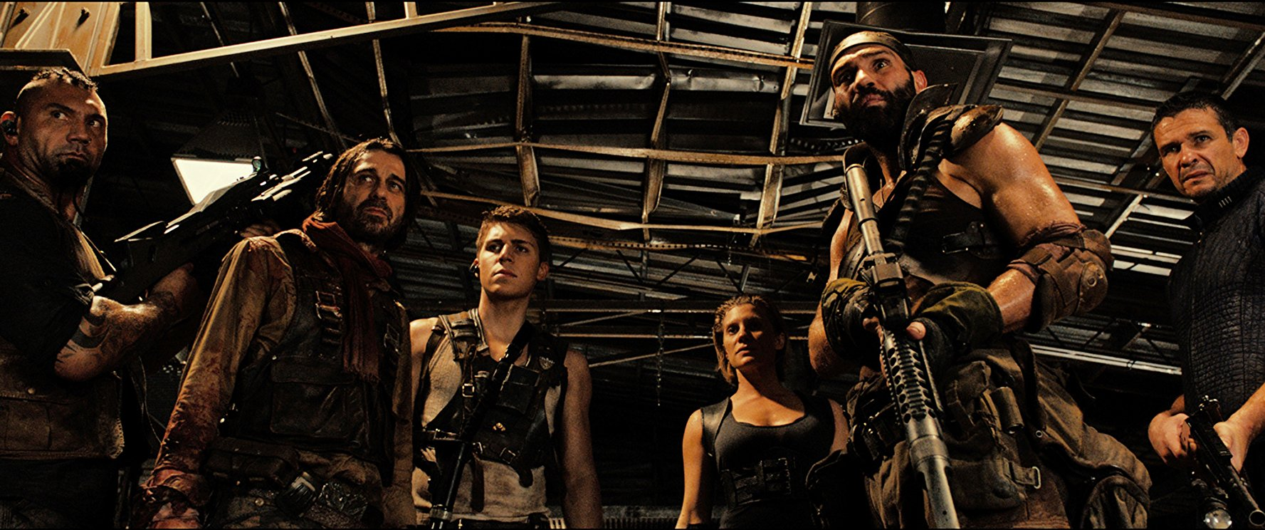 The pursuing mercenaries - (l to r) Dave Bautista, Nolan Gerard Funk, Jordi Mollà, Katee Sackhoff, Conrad Pla and Matt Nable in Riddick (2013)