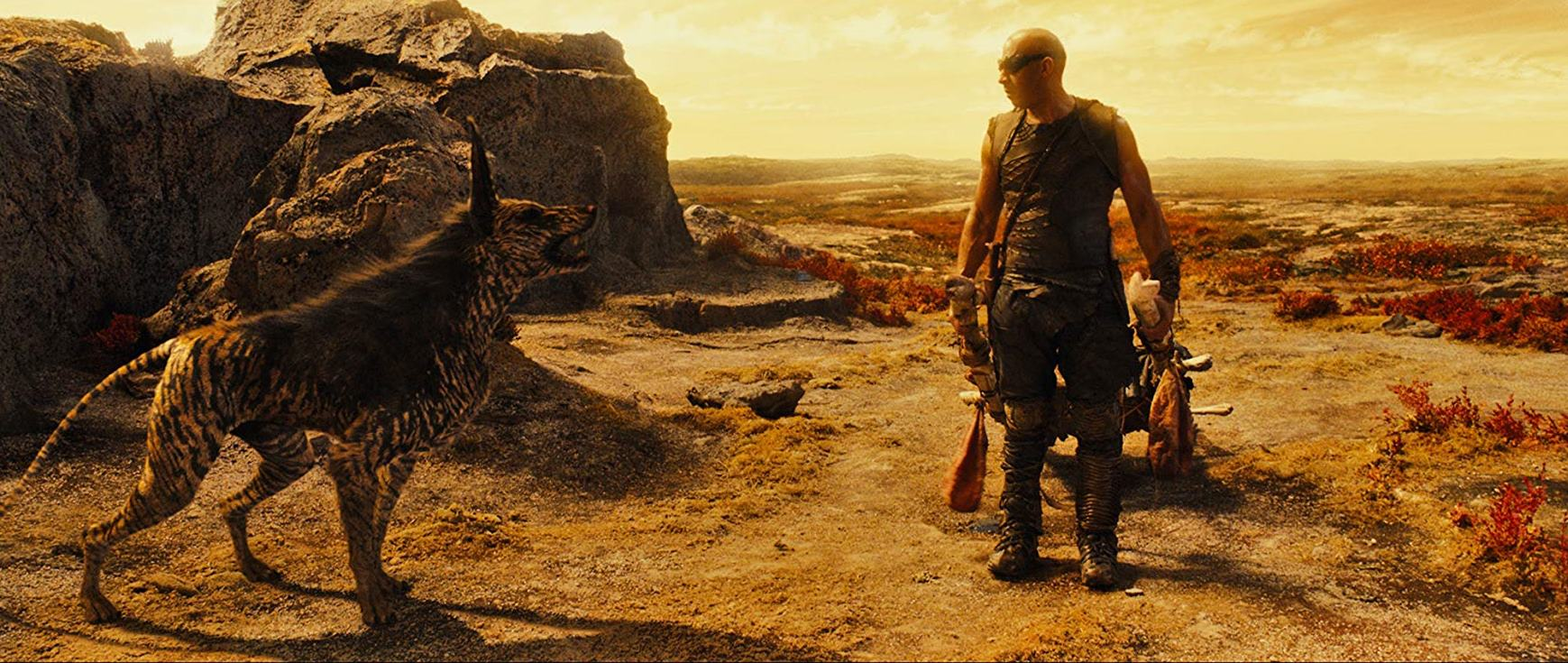 Riddick (Vin Diesel) and alien pet in Riddick (2013)