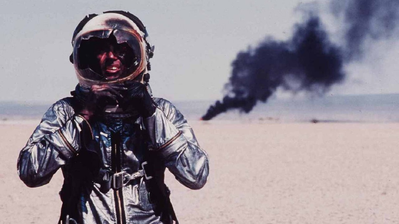 Chuck Yeager (Sam Shepard) walks away from a crash in The Right Stuff (1983)