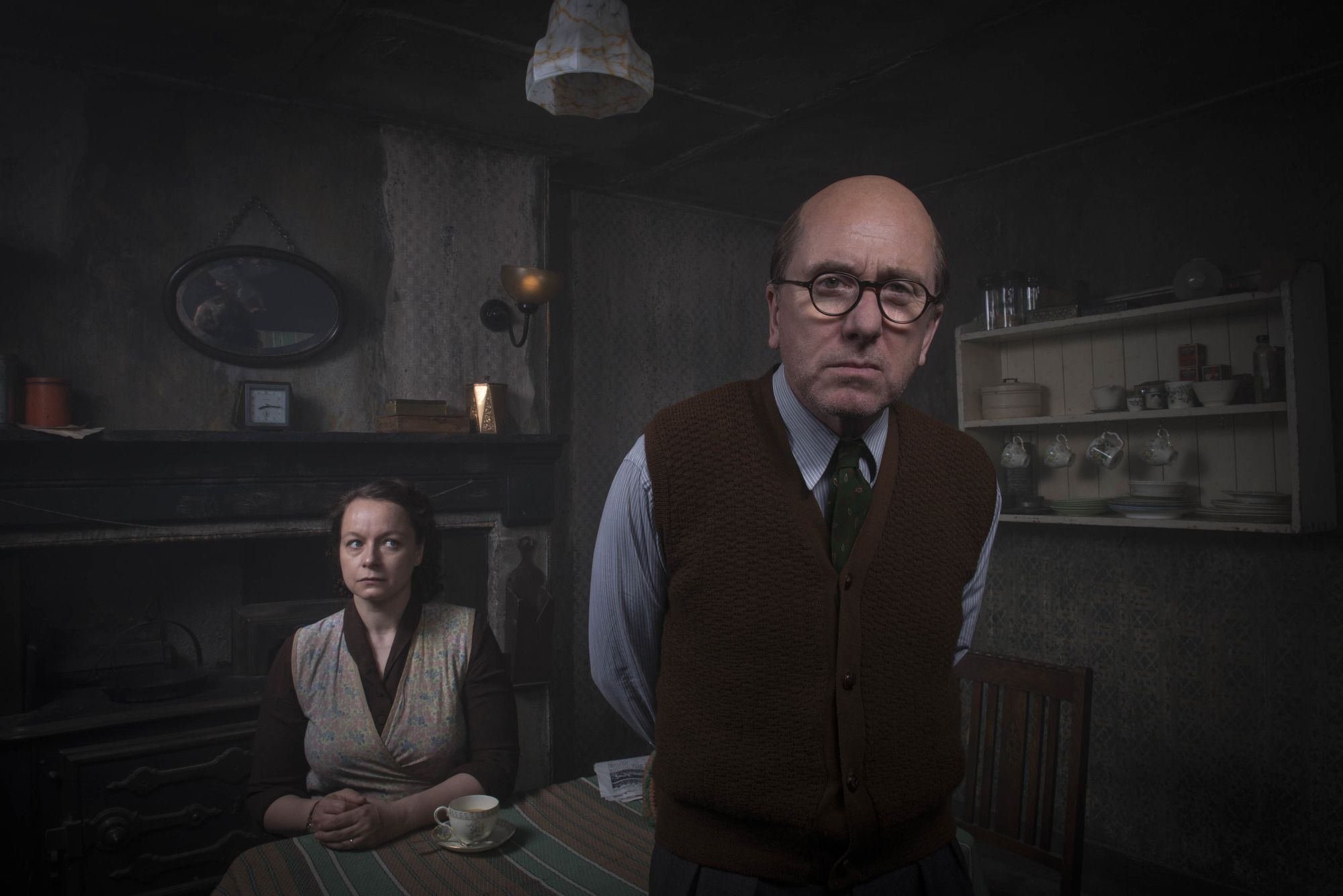 Tim Roth as serial killer Reginald Christie and with Samantha Morton as his wife Ethel in Rillington Place (2016)