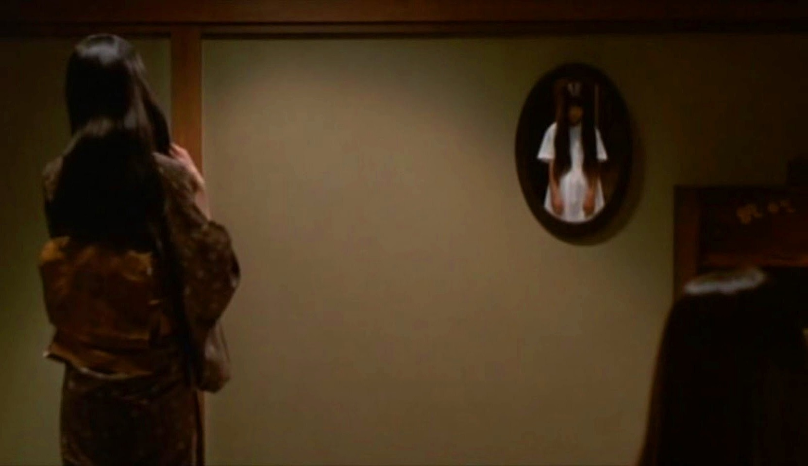 Ghostly figures in the mirror in Ring 2 (1999)
