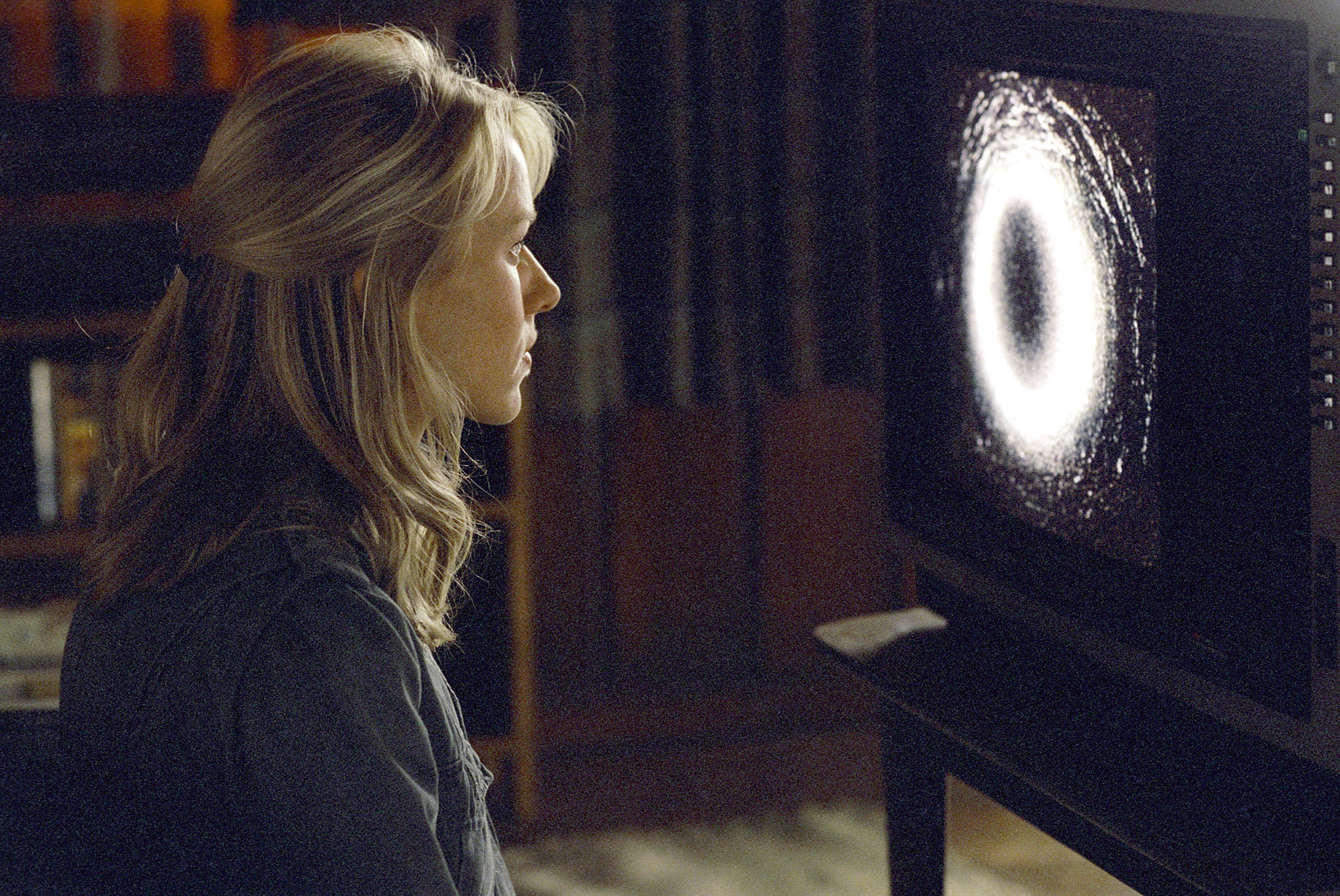 Naomi Watts sits down to watch the cursed videotape in The Ring (2002)