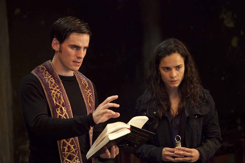 Colin O'Donoghue as novice priest Michael Kovak, along with journalist Alice Braga in The Rite (2011)