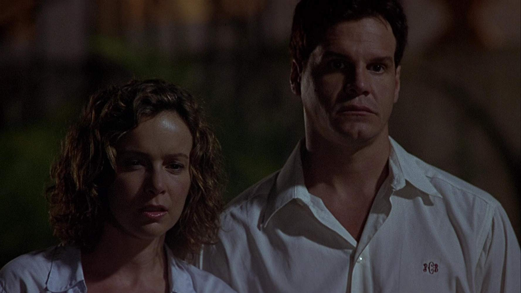 Jennifer Grey and Craig Sheffer face voodoo in Ritual (2002)