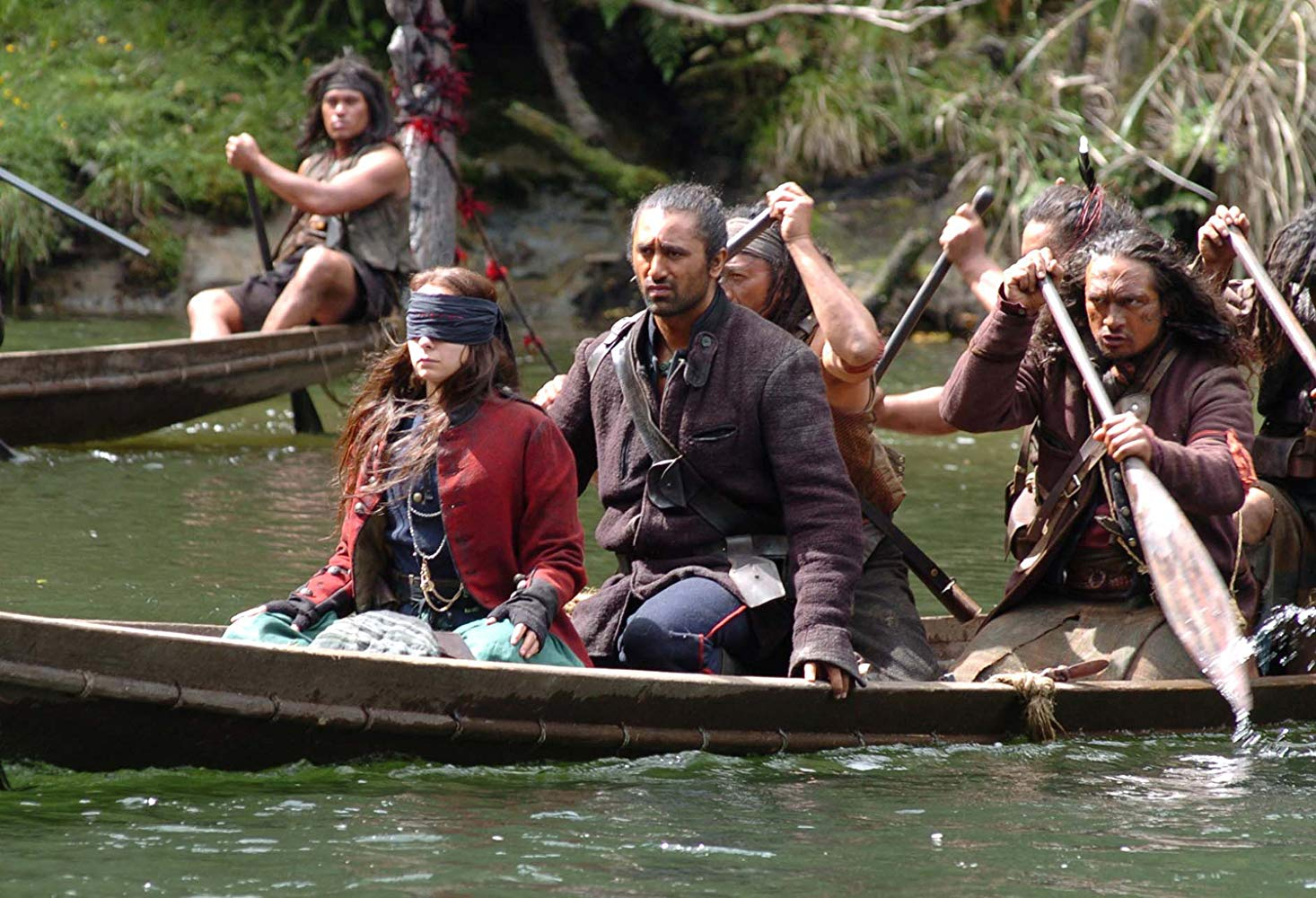 A blindfolded Samantha Morton travels into The Interior in a waka guided by Wiremu (Cliff Curtis) in River Queen (2005)