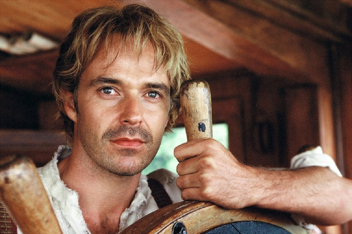 Cameron Daddo as Samuel Clemens at the wheel of his riverboat in Riverworld (2003)