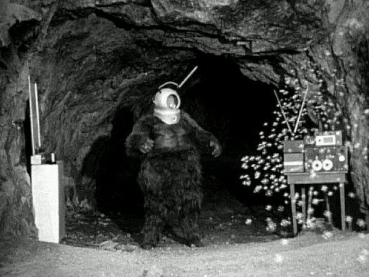 Ro-Man (George Barrows) in his cave with the Automatic Billion Bubble Machine in Robot Monster (1953)