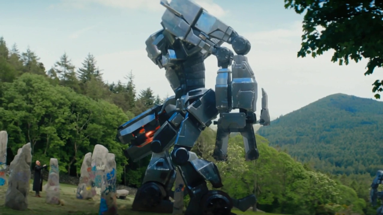 Ben Kingsley and robot overlord in Robot Overlords (2014)