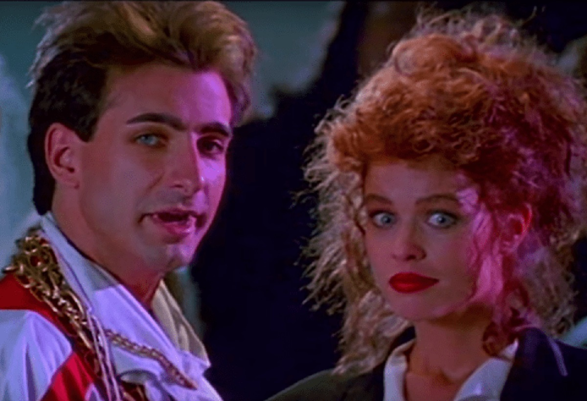 Vampire teenager Ralph (Dean Cameron) and his reincarnated lady love Mona (Tawny Feré) in Rockula (1990)
