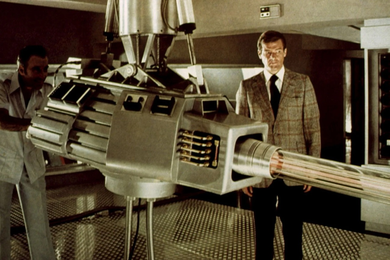 Scaramanga (Christopher Lee) demonstrates the Solex Agitator laser to James Bond (Roger Moore) in The Man With the Golden Gun (1974)