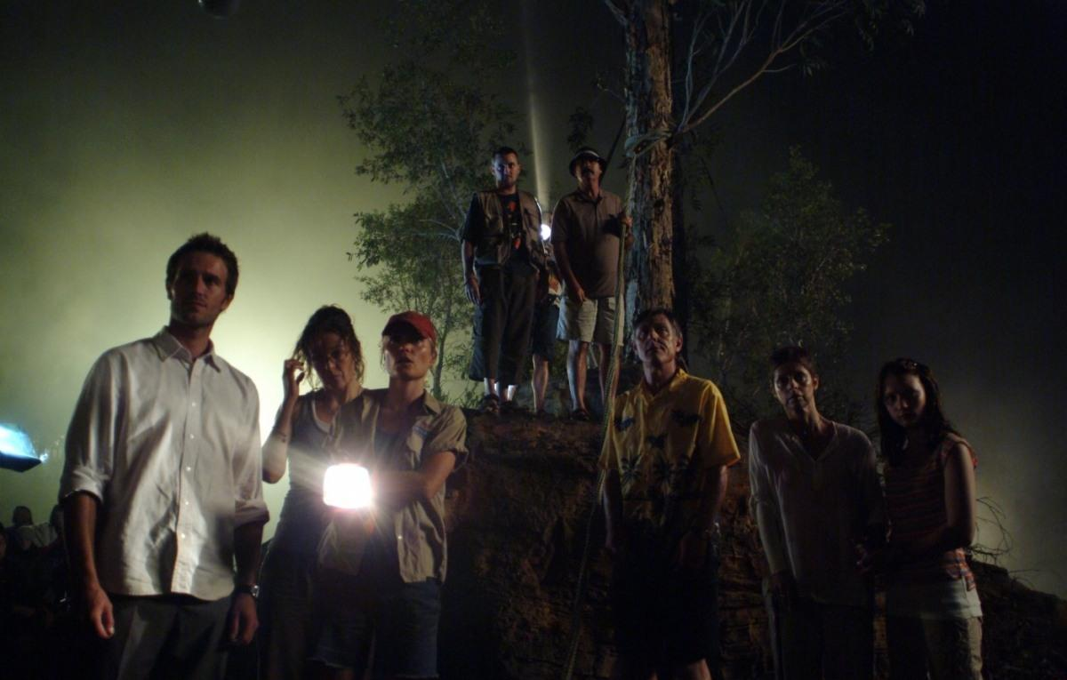 Party of tourists stranded on a mudflat in Rogue (2007)