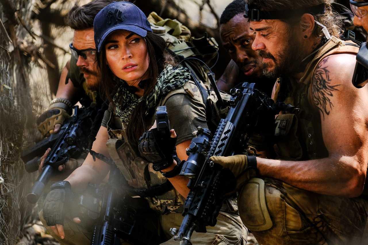 Mercenaries Grief Kriek, Megan Fox, Sisanda Henna and Brandon Auret in Rogue (2020)