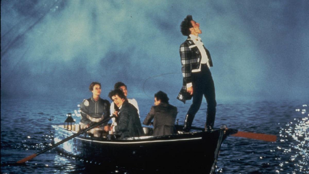 Hugh Grant, Jose Luis Gomez, Valentina Pelka, Elizabeth Hurley and Lizzy McInnerny go boaing on Lake Geneva in Rowing with the Wind (1988)