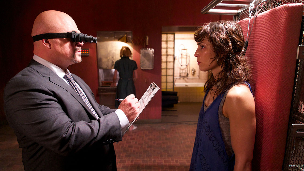 Noomi Rapace held prisoner as Michael Chiklis oversees experiments on her in Rupture (2016)