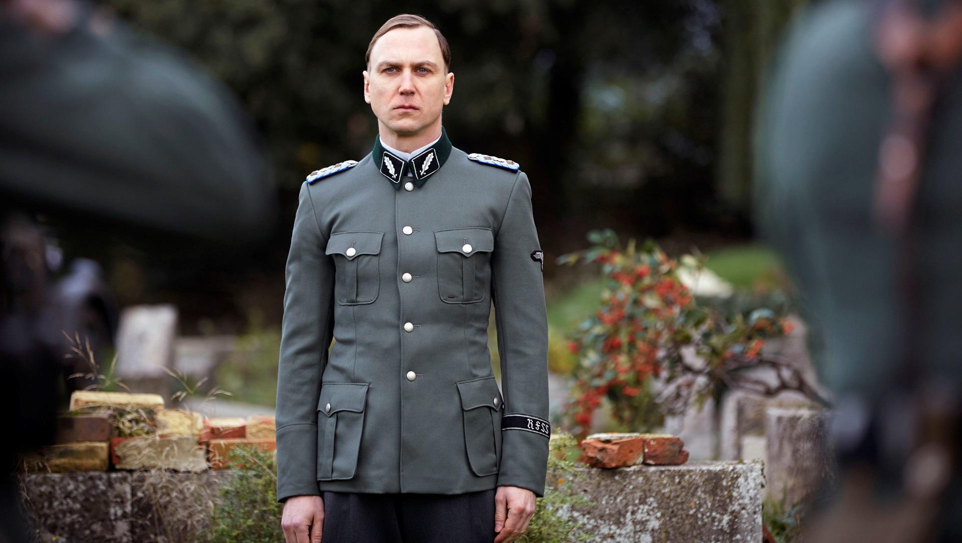 Lars Eidinger as Sturmbahnfuhrer Dr Oskar Huth in SS-GB (2017)