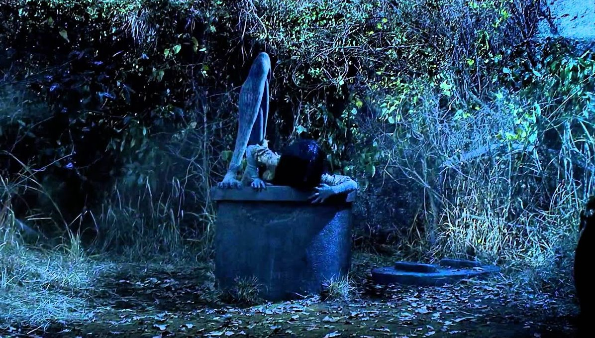 A 3D CGi Sadako emerges from the well in Sadako 3D (2012)