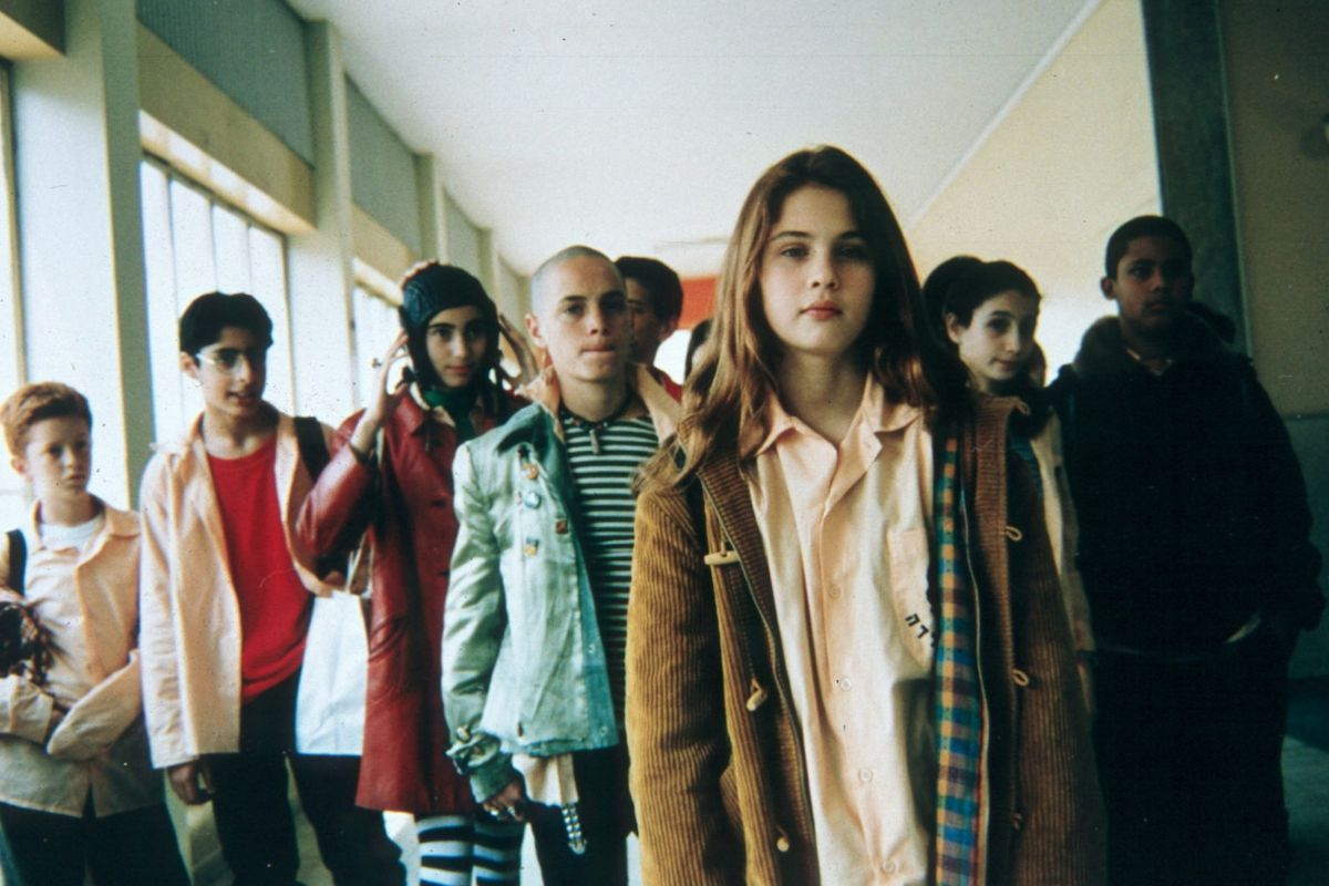 Clara (Lucy Dubinchik) (front centre) and her fellow pupils in Saint Clara (1996)