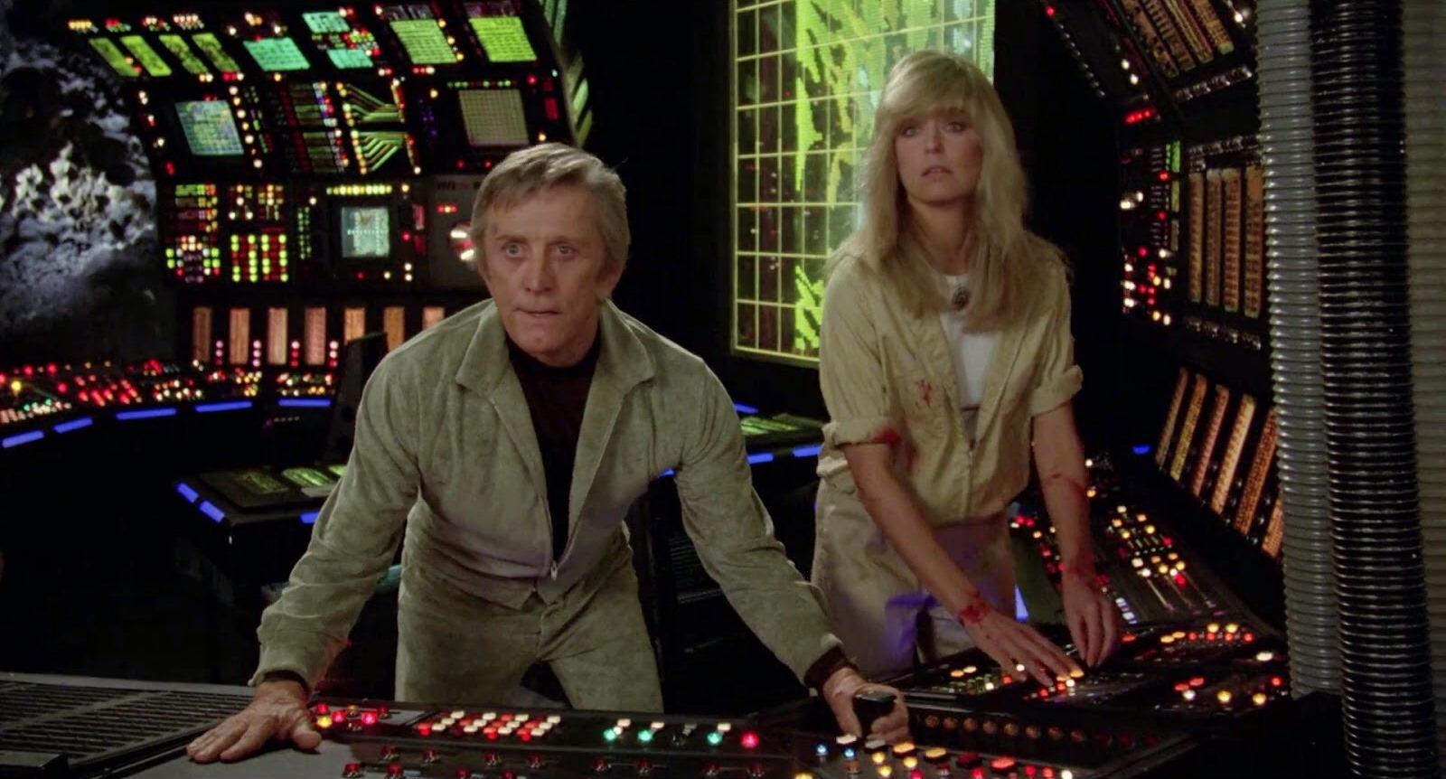 Adam (Kirk Douglas) and Alex (Farrah Fawcett) - lovers manning a station on Saturn's moon Triton in Saturn 3 (1980)