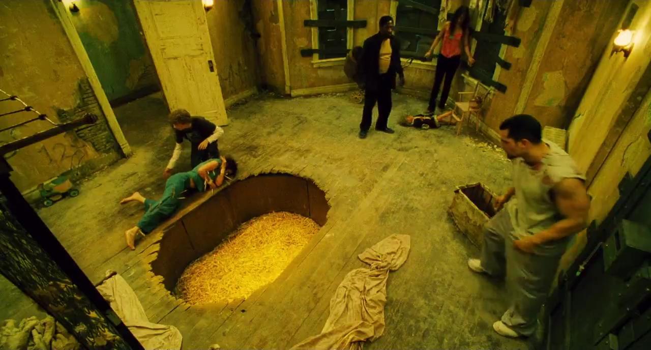 Seven people trapped in a house by Jigsaw - Shawnee Smith, Erik Knudsen, Glenn Plummer, Emmanuelle Vaugier, Franky G in Saw II (2005)
