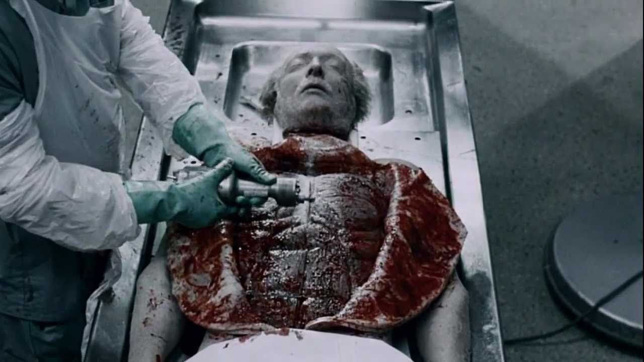 Jigsaw (Tobin Bell)'s autopsy with no anatomical detail spared in Saw IV (2007)