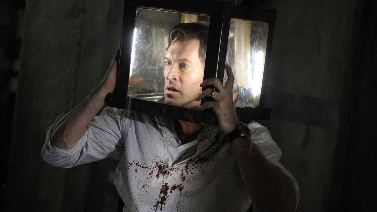 Scott Patterson with his head trapped in a box filling with water in Saw V (2008)